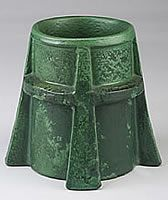 Wheatley Pottery was established in 1903 by T.J. Wheatley. Wheatley Pottery produced arts and crafts style pottery of a similar style to Grueby Pottery. Wheatley Pottery is characterized by forms, decorated in relief, and covered in thick matte green, blue, and yellow glazes. It is believed that the production of art pottery at Wheatley ceased by 1910.
