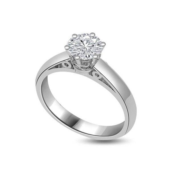 ANELLO DI FIDANZAMENTO SOLITARIO CON DIAMANTE 18CT ORO BIANCO | Solitario con diamante taglio brillante montato in 6 griffe. L`anello è disponibile in 18ct oro bianco, 18ct oro giallo e in platino. Il peso dei carati del diamante può variare da 0.20ct a 0.60ct ed il colore da F ad H e la purezza da VS1 ad SI1. L`anello è accompagnato dal certificato del diamante. Perfetto per fidanzamento, matrimonio o anniversario e come regalo nel giorno di San Valentino.
