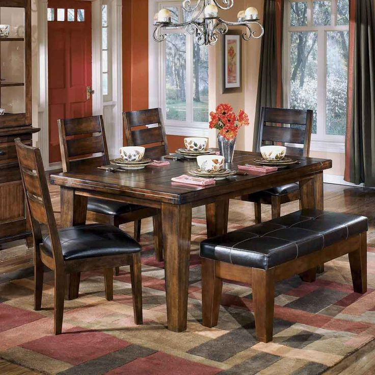 Larchmont Rectangular Dining Table, 4 Chairs, and 1 Bench by Signature Design by Ashley   Part of the Larchmont Collection Sku: D442-25+01+00 Store Availability: In Stock and On Display Compare At Price: $2,199.94 Sale Price: $1,219.94