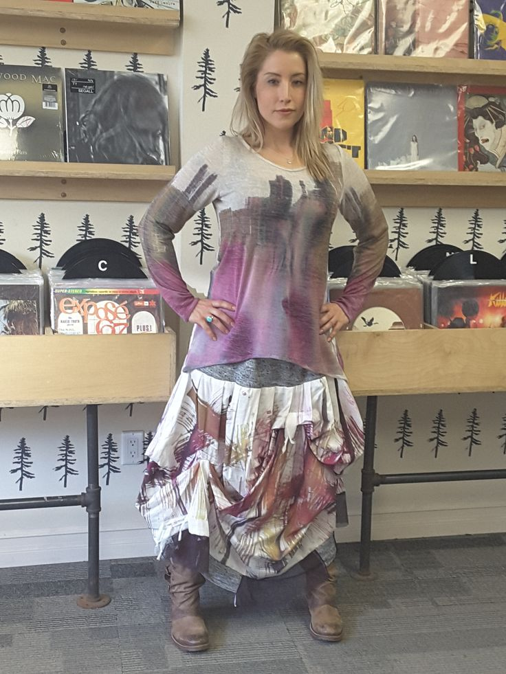 WATER ELEMNETS    Distinctive hand painted top and skirt.Limited edition.Sculptured skirt has soft elastic waist. This flowing water colour technique gives each garment its distinct flavor. It cannot be duplicate which makes each captivating. The asmmetric design with organic fabrics gives soft flowing lines. Pack and go for easy travel   Colour is set but may still release. Hand wash separately in cool water with a cup of salt.