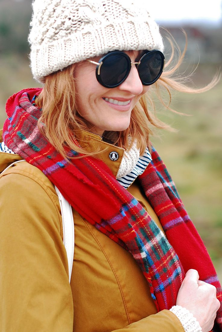 Cold weather preppy outfit for the coast: Brown Barbour jacket \ cream bobble hat and roll neck \ red tartan scarf \ black skinnies and riding boots   Not Dressed As Lamb, over 40 style blog