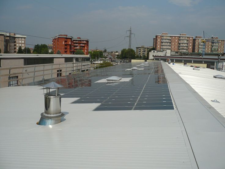 """Commercial solar plant. When the Italian regulation required """"building integrated"""" modules to grant incentives. Italy 2010"""