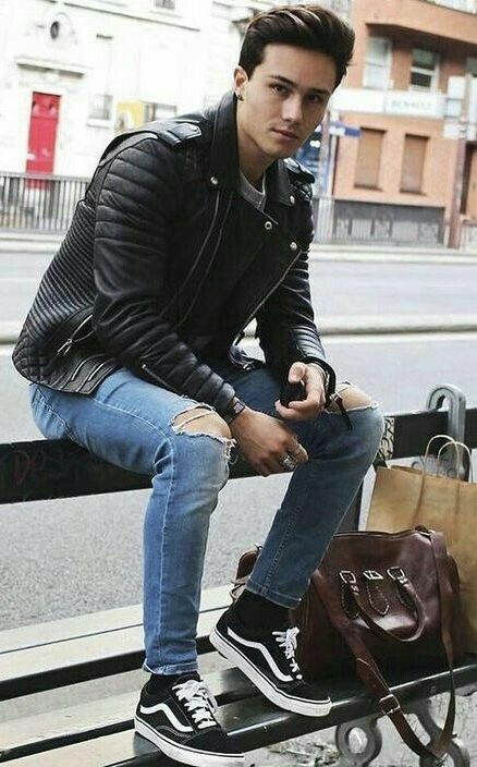 b9c37f7286 Fall combo inspiration with a black moto leather jacket ripped jeans black  socks black old skool canvas vans white shirt brown leather duffle bag.  model ...