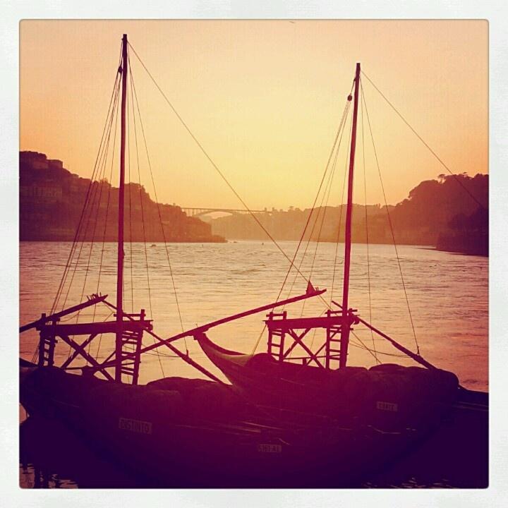 Porto wine old boats in Douro River. Oporto city. Portugal.