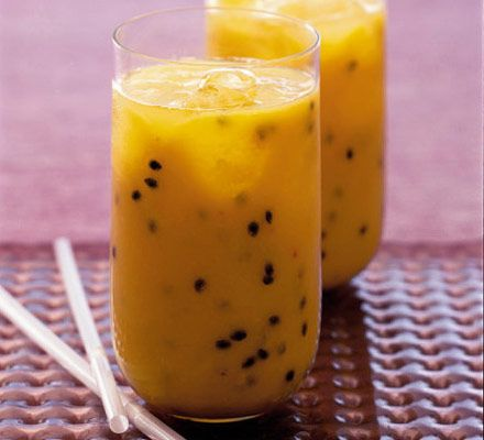 TROPICAL BREAKFAST SMOOTHIE  Scoop the pulp of the passion fruits into a blender and add the banana, mango and orange juice. Purée until smooth and drink immediately, topped with ice cubes.