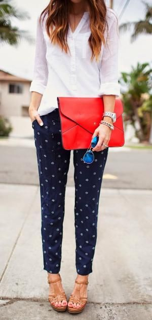 Merrick White is wearing trousers and top from old navy, red bag and mirrored sunglasses by bethany