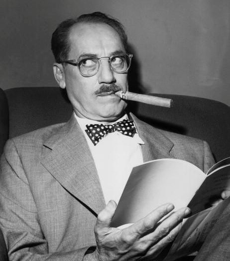 "Groucho - ""Outside of a dog, a book is a man's best friend. Inside of a dog it's too dark to read."""