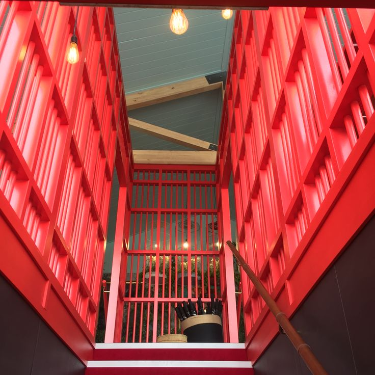 entry staircase as red birdcage by matt martino