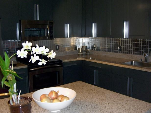 Loving the dark cabinets and the mirrored backsplash