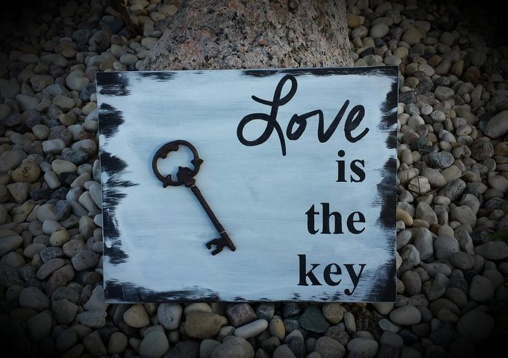 made on an old piece of repurposed wooden shelving with gorgeous cast iron key