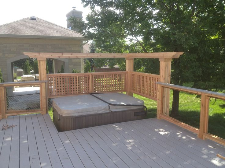hot tub deck pictures | Custom decking project with sunken hot tub area and glass barrier.