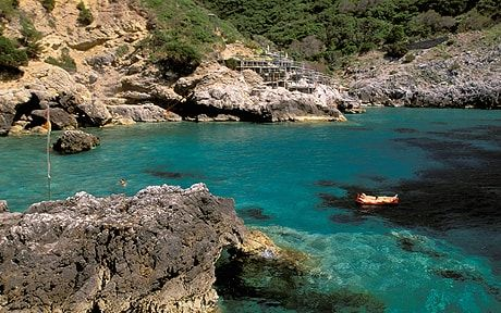 The rugged, exclusive area of Monte Argentario is home to Cala Piccola, a   rocky cove with a small pebble beach and translucent aquamarine water.