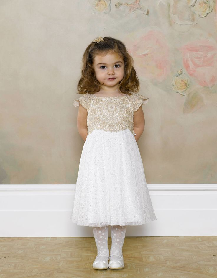 Baby Estella Sparkle Dress  2582443222  £40.00  Pretty sparkle party dress, lace bodice with delicate capped sleeves, sequin detailing along neckline, satin shine lining and tie back belt .: