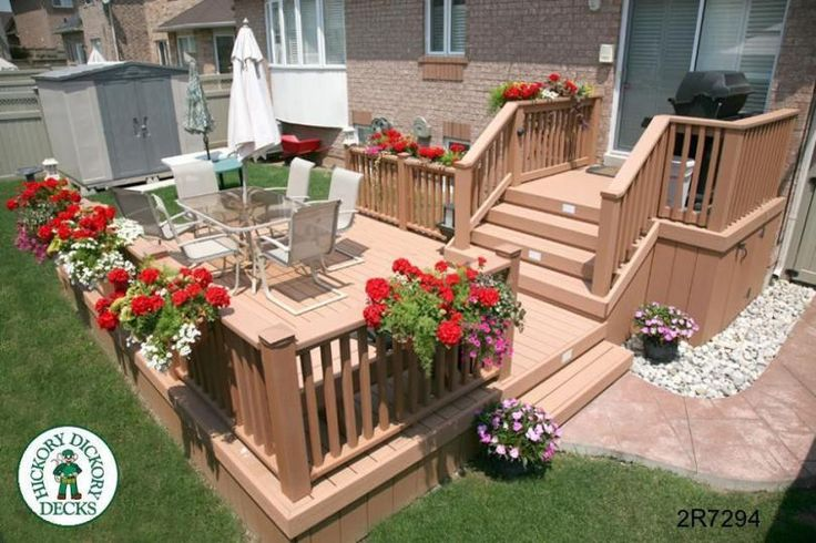 Large, 2-level, mid-height deck with a bench (#2R7294).