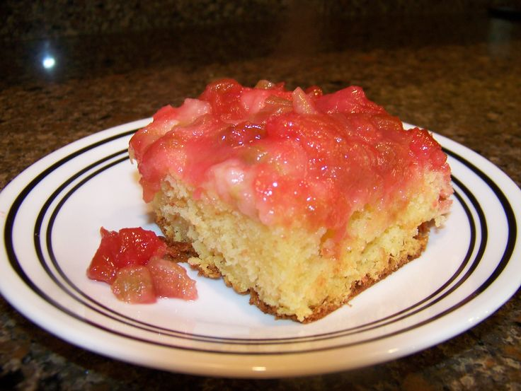 Rhubarb Cake - spread out rhubarb in pan, sprinke with one package flavored Jello (raspberry) and 1/2 cup sugar and then dot with butter then cover with a white cake (mixed based on directions).  Never fails to please, ever.