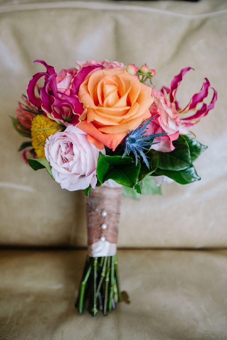 Aqua & Orange Beach Wedding flowers that are so beautiful that I can see Emily loving.