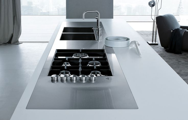 Worktop Bimaterico in DuPont Corian glacier white and steel with personalised sinks and hob Varenna by Foster.