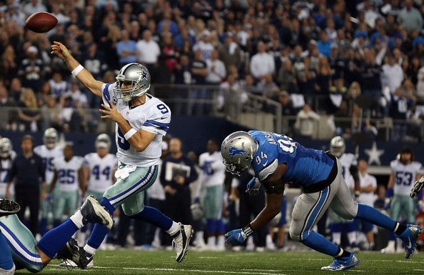 Tony Romo Photos Photos - Tony Romo #9 of the Dallas Cowboys throws a touchdown pass to Terrance Williams #83 of the Dallas Cowboys as Ezekiel Ansah #94 of the Detroit Lions rushes during the second half of their NFC Wild Card Playoff game at AT&T Stadium on January 4, 2015 in Arlington, Texas. - Wild Card Playoffs - Detroit Lions v Dallas Cowboys