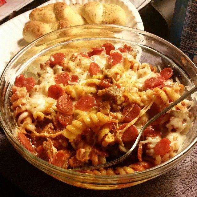"""You're not going to want to miss this Easy Pizza Pasta recipe: Ingredients: 8 oz pasta, 2 24oz jars Ragu Spaghetti Sauce, 1 Package Pepperoni, Italian Sausage or ground beef or both (depending on how much meat you want), an 8 oz package of mozzarella cheese. Directions: 1. Brown the meat 2. Cook and drain pasta 3. Heat oven to 375 degrees F 4. Mix pasta sauce, meat, pepperoni, and pasta (either in a separate bowl or in 9x13"""" pan) 5. Cover the dish and place it in the oven!"""