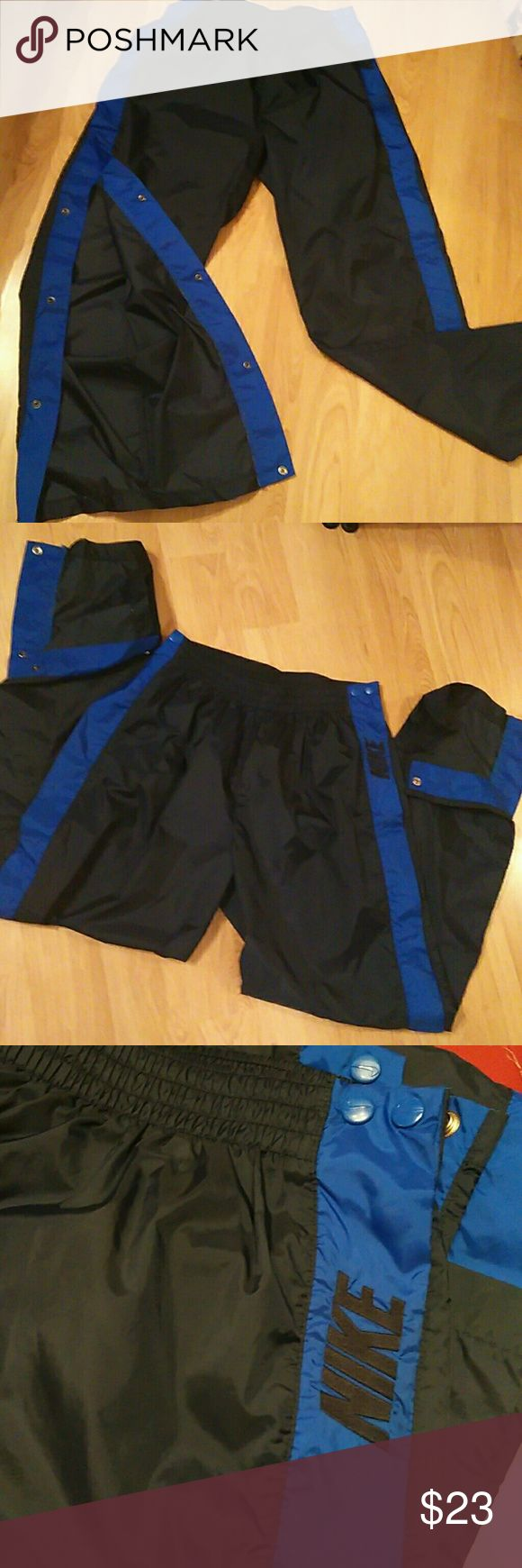 """Men's Nike Fully Tear-away Nylon Athletic Pants 31"""" inseam.  30"""" waist without  being stretched. Navy Blue with royal blue accents. Excellent Condition. All working snaps. Nike Pants Sweatpants & Joggers"""