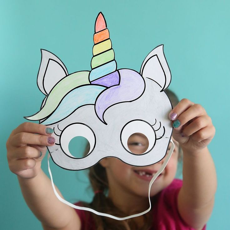 Adorable DIY unicorn masks that you print out and let the kids color! Free printable kids unicorn coloring page. How to make a unicorn mask. Birthday party.