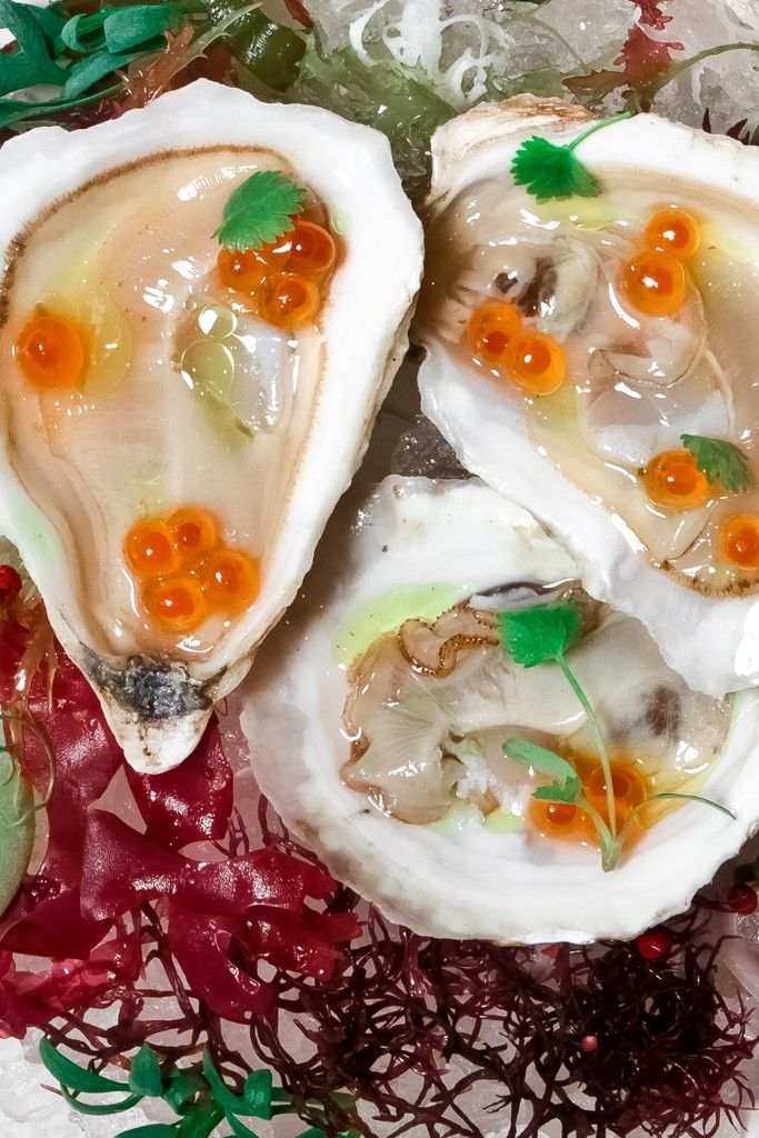 Montauk Pearl Oysters topped with a toasted curry oil, salmon caviar, chervil over a bed of wakame. [Courtesy Photo]