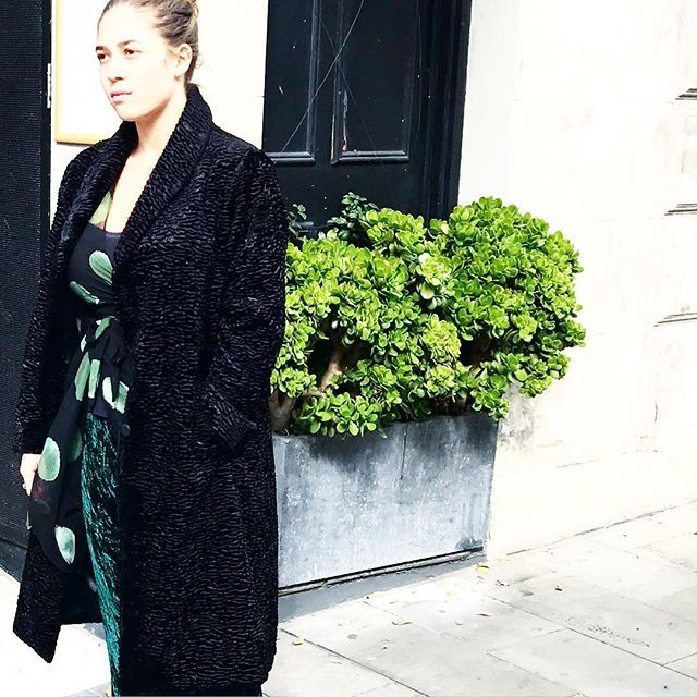 Astrakhan coat layered over silk wrap and silk velvet bias skirt... perfect winter layering in store and online @jiva_cl...