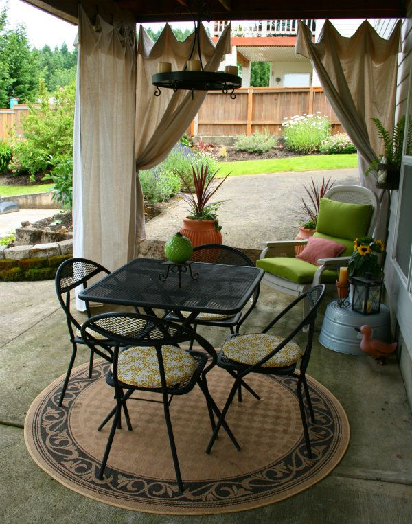 This is what I want to do under our deck. Gather up some unwanted furniture from others and repaint it, make cushions, drop cloth curtains and it could be cheap!!