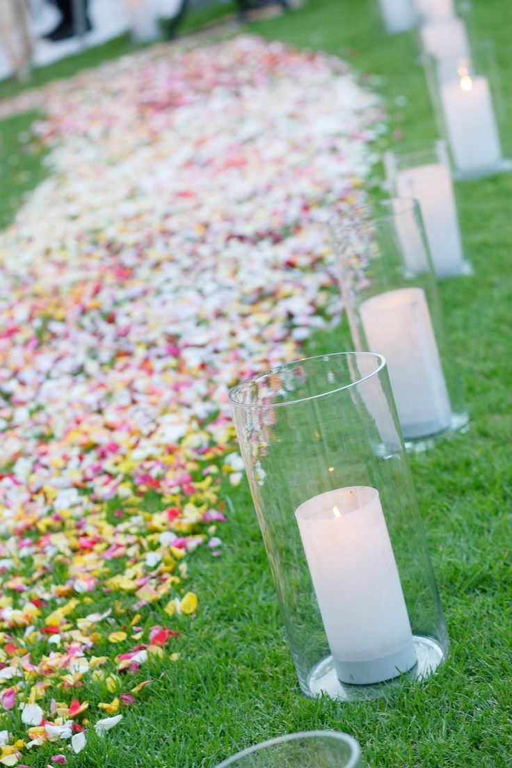 OKASIE | Scattered rose petal aisle & glass cylinders with candles