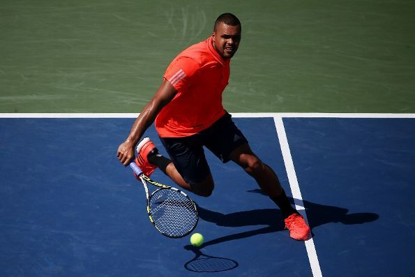 #Tsonga #2015USOpen #tennis Jo-Wilfried Tsonga of France returns a shot to Benoit Paire of France during their Men's Singles Fourth Round match on Day Seven of the 2015 US Open at the USTA Billie Jean King National Tennis Center on September 6, 2015 in the Flushing neighborhood of the Queens borough of New York City. (Photo by Streeter Lecka/Getty Images)