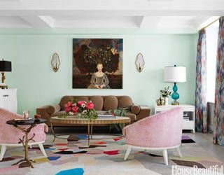 """To bring a feeling of nature into a New York living room, designer Fawn Galli used a custom minty green: """"I don't think a color should be too saturated or strong on a wall."""" Pal + Smith chairs in a cheetah print — Safari by Manuel Canovas — with a Paley sofa from Profiles, a Fiona Curran Palette carpet for the Rug Company, and a painting by Anne Siems give the room """"a sense of storybook fantasy."""""""