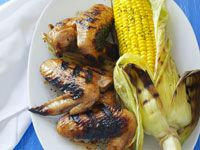 Sticky chicken wings with barbecued corn cobs