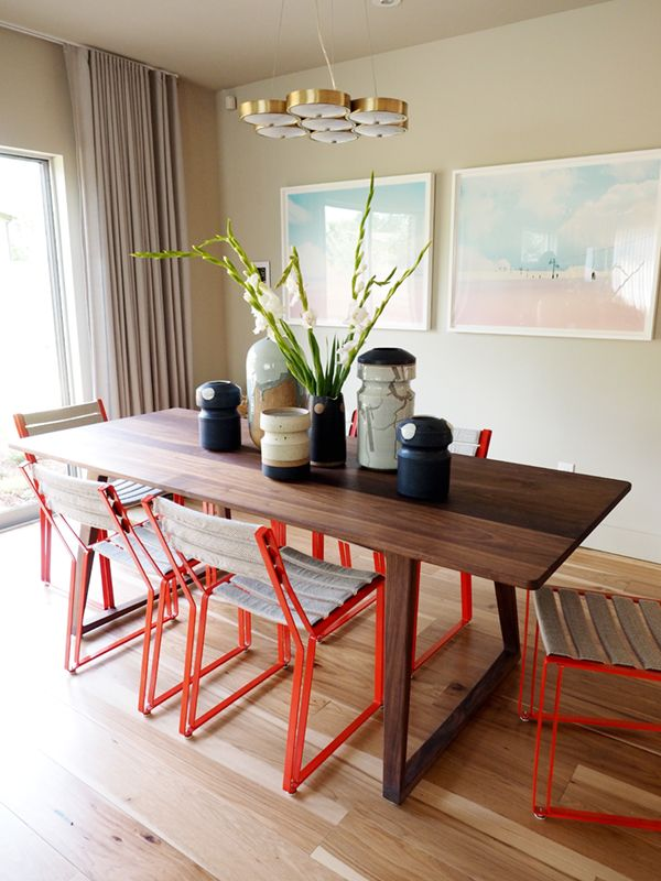sunset idea house tour - dining room with red chairs | via coco+kelley