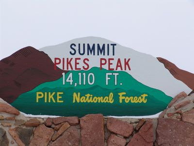 "Summit of Pikes Peak. (Dad and I drove in the car while Mom stayed behind as our family's ""Pikes Peak Chicken"". Don't blame her...those roads were harrowing!)"