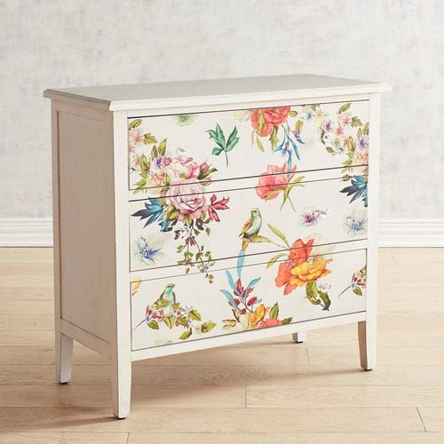 Our beautiful three-drawer design is proof: Florals aren't just for pillows and wall decor anymore. The colorful charm and artistry of our chest enliven your home with its classic lines, ample storage and feminine style. It's crafted of hardwoods and has acrylic knobs.