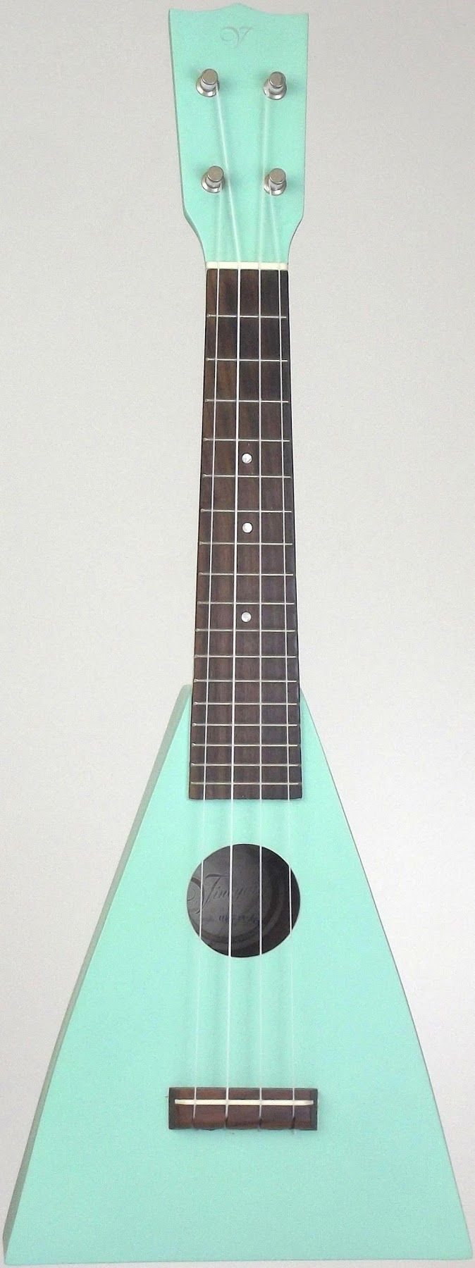 New pic of my sea green Vineyard Triangle Soprano - this is a great ukulele and it does stand up on its own