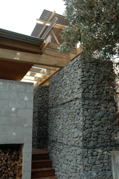 Lindale Beach House with Gabion Spine in New Zealand by Herbst Architects