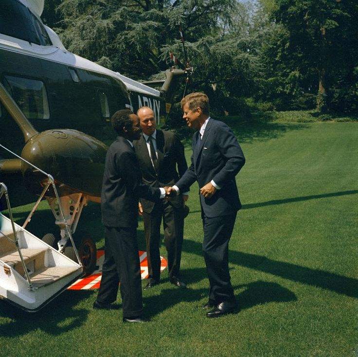 JFK greets Julius Nyerere, the President of Tanganyika, upon Nyerere's arrival at the White House (July 15, 1963).