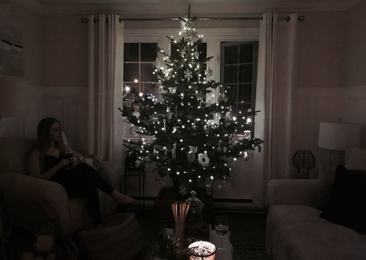 Christmas tree hunting and decorating at the Mayflower Cottage in Renews, Newfoundland https://goo.gl/2gL283 rustic cabin Christmas, cozy winter outfit, fur hat, blanket scarf, hunter boots, fur pompom, how to decorate, all white Christmas decor, wool coat, plaid, stripes, what to wear