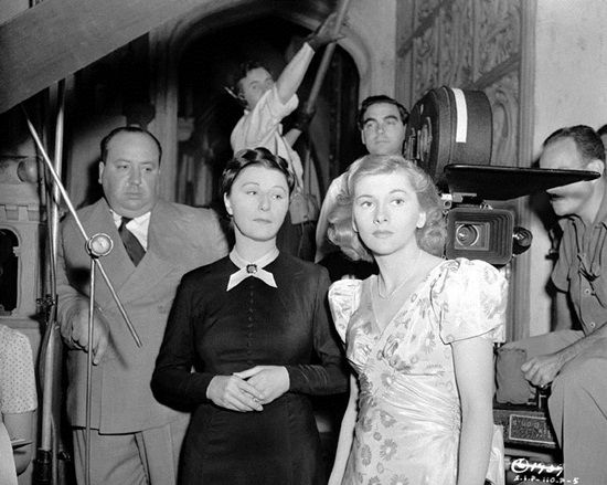 "Alfred Hitchcock, Judith Anderson and Joan Fontaine on the set of ""REBECCA"" (1940)."