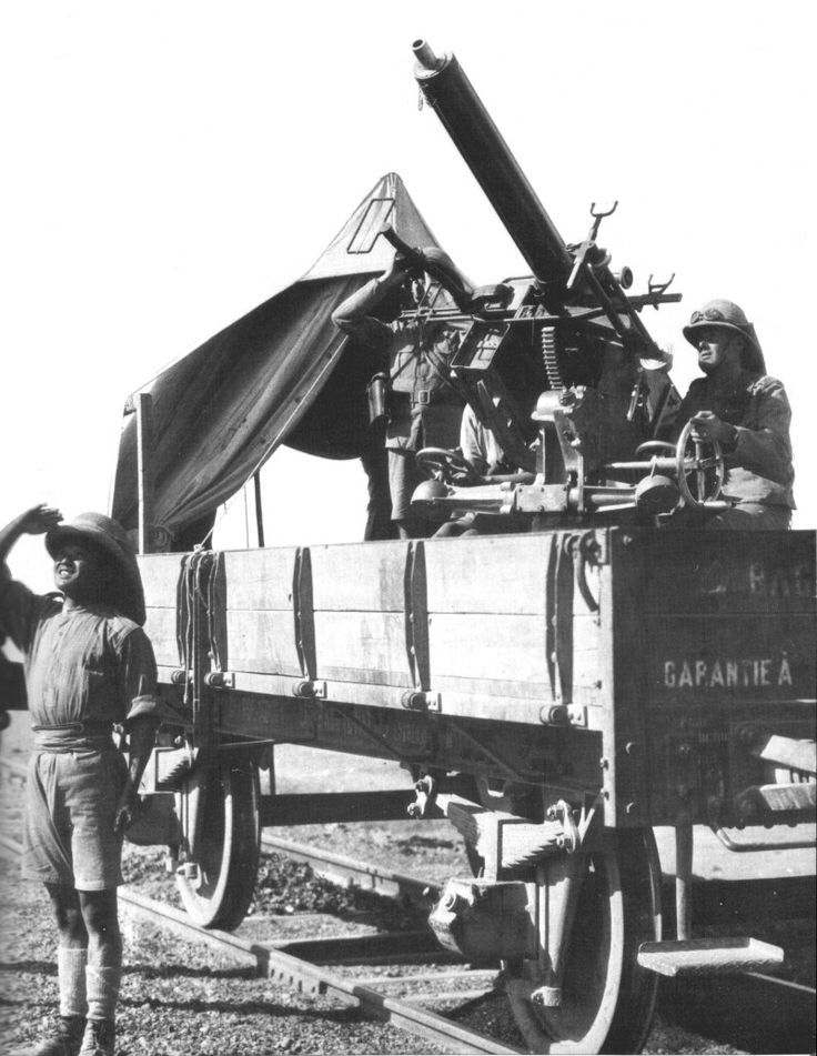 1 Pounder 'pom pom' anti-aircraft gun mounted on a goods truck of the Baghdad…