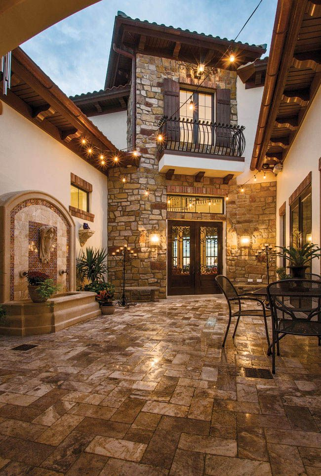 Custom doors lead to a Tuscan-inspired getaway
