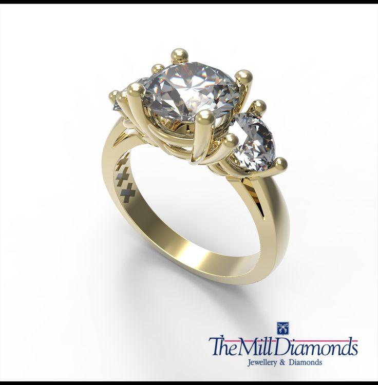 Three (3) stone ring design. Yellow gold with 3 brilliant cut diamonds.