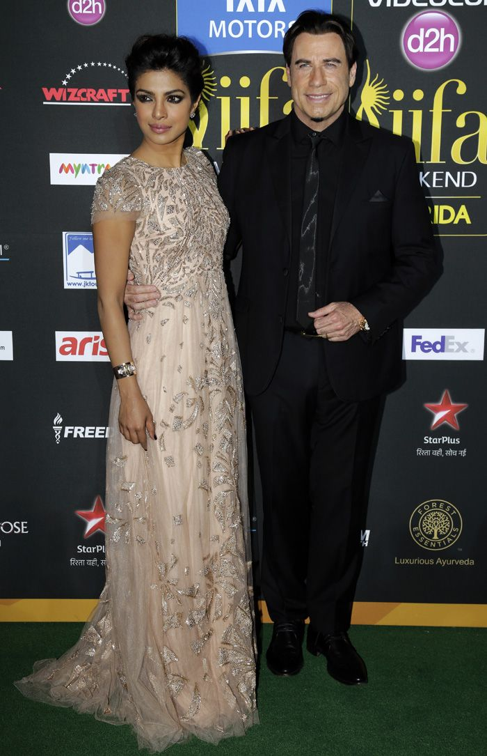 Priyanka Chopra is happy to pose with John Trovolta.