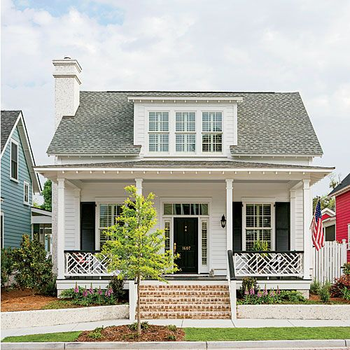 This house is so charming! I love the white and black with the brick. Classic Exterior