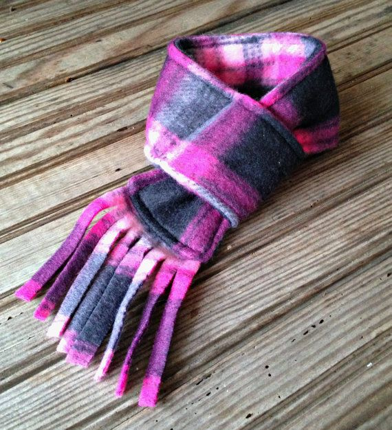 This handmade Furever Gracie Pink Plaid Winter Dog Scarf with fringe edge is made of soft, warm fleece and is available in 3 sizes. Easy to use and adjust to fit your dogs neck by pulling the fringe edge through the loop on the other end. MAKES A GREAT GIFT FOR YOUR FAVORITE PUP!! SMALL - 2 1/2 wide scarf, fits up to 12 neck size MEDIUM - 3 1/2 wide scarf, fits 10 - 17 neck size LARGE - 4 1/2 wide scarf, fits 14 - 22 neck size This Dog Scarf is machine washable. Want 20% o...