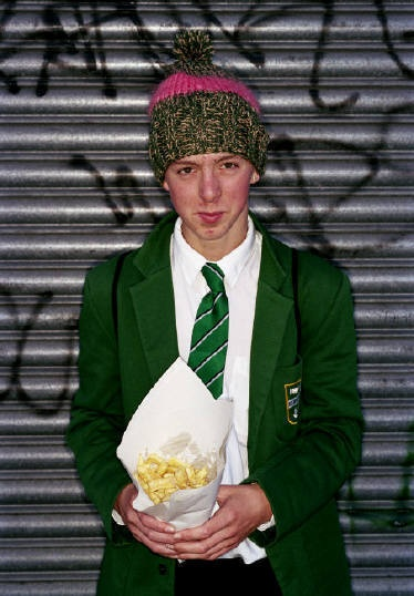 -environmental -urban background/setting -stereotypical (school boy with chips)