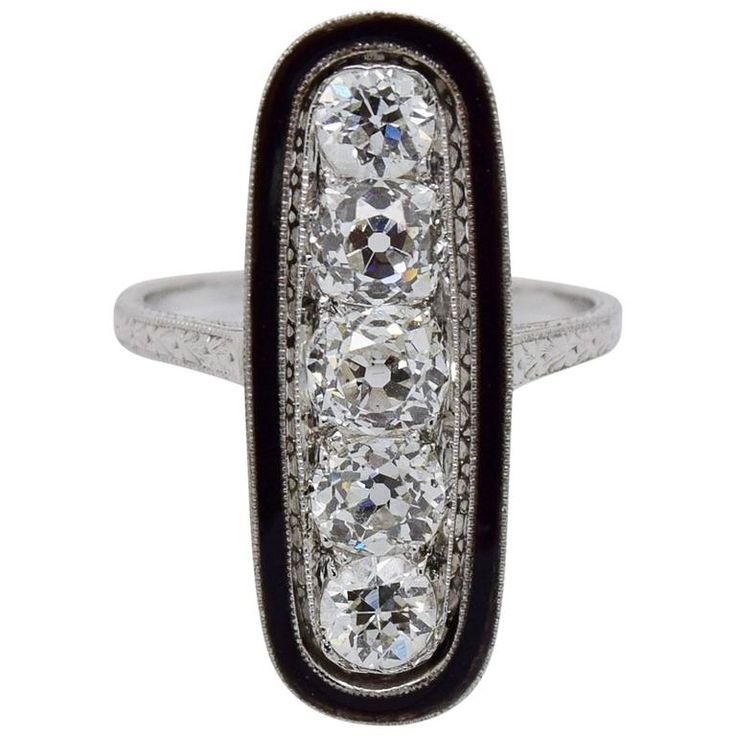 1920s Art Deco Diamond, Black Enamel and Platinum Dinner Ring | From a unique collection of vintage cocktail rings at https://www.1stdibs.com/jewelry/rings/cocktail-rings/