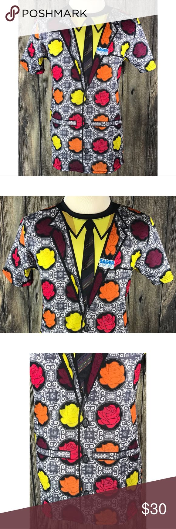 """Craig Sager NBA Sager Strong Cancer Tribute Shirt Craig Sager NBA Basketball Announcer Sager Strong Cancer Tribute Shirt Small 500 Level. New without the tags. Floral tux with black tie in representation of Craig Sanger's stylish sport coats worn during announcing for the NBA. Measurements are approximate arm pit to arm pit laying flat 19""""; shoulders 17""""; sleeves 8""""; length 29.5"""". Shirts Tees - Short Sleeve"""