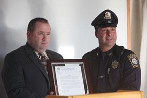 Ptl. Salvati receiving an award after rushing into a burning home and saving an elderly resident